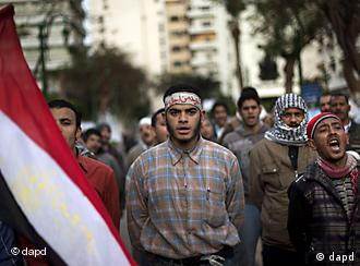 Protesters walking down street, Egyptian flag