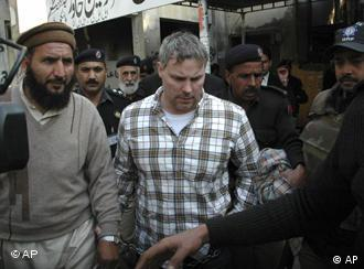 Pakistani security officials escort Raymond Davis, a U.S. consulate employee, center, to a local court in Lahore