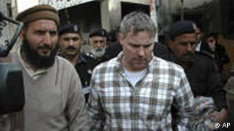 Pakistani security officials escort Raymond Allen Davis, a US consulate employee, center, to a local court in Lahore, Pakistan (Photo: AP Photo/Hamza Ahmed, File)