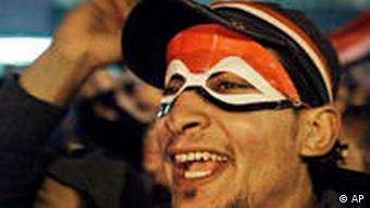 Man with face painted in colors of Egyptian flag