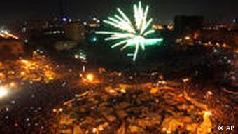 A crowd of Egyptians lights fireworks in celebration