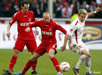 Cologne and Mainz players fight for the ball