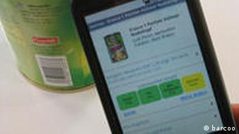 A smartphone shows information based on the bar code of a can of food