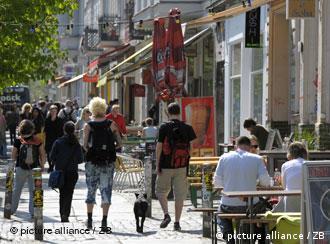 People walking down a street in Berlin