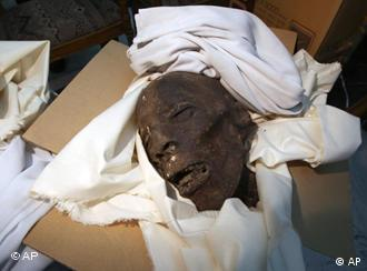 This undated photo provided Monday Feb.7, 2011 by the Egyptian Museum shows a damaged skull of the Late Period, in Cairo, Egypt