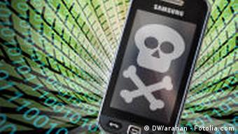 Cellphone with skull and crossbones symbolizing data theft