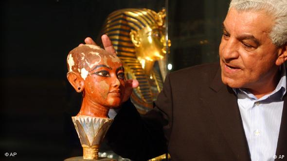 Zahi Hawass, seen here with an ancient statue of King Tutankhamun