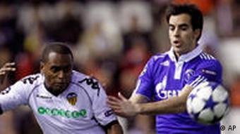 Valencia's Miguel Brito, left, duels for the ball with Schalke 04's Jose Manuel Jurado