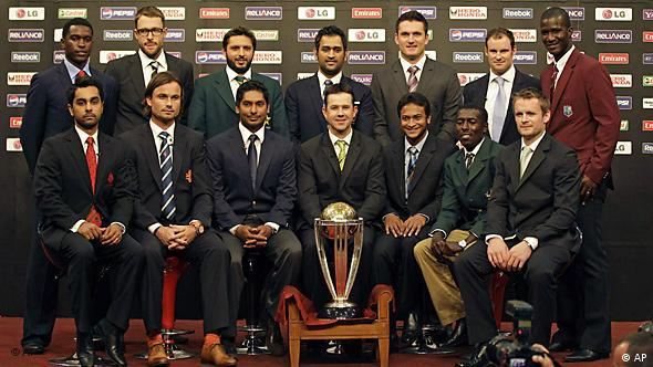 The 14 national captains pose with the ICC Cricket World Cup trophy in Dhaka, Bangladesh