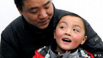 Peng Gaofeng holds his 6-year-old son Peng Wenle, who was lost for three years, in his arms after finding him
