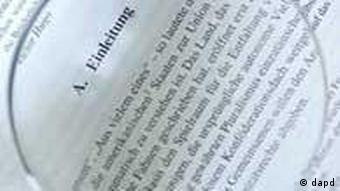 Part of the opening page of the offending thesis, viewed with a magnifying glass