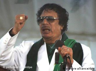 epa02586762 Libyan leader Muammar Gaddafi delivers a speech at a foundation stone laying ceremony of the Al Ahly Club Tripoli, in Tripoli, Libya, 16 February 2011. According to news reports early 16 February, at least 38 people were injured when police clashed with hundreds of demonstrators in the Libyan city of Benghazi overnight. EPA/SABRI ELMHEDWI