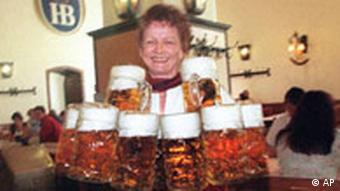 A waitress carrying a load of one-liter beer steins