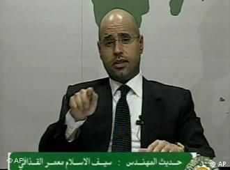 In this video image broadcast on Libyan state television early Monday Feb. 21, 2011 Seif al-Islam, son of longtime Libyan leader Moammar Gadhafi, speaks. Al-Islam says protesters have seized control of some military bases and tanks, and also warned of civil war in the country that would burn its oil wealth. (AP Photo/Libyan State Television) TV OUT LIBYA OUT