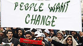protesters in rabat carrying a sign saying people want change