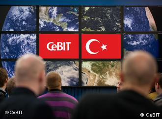 A computer screen shows the Turkish flag at CeBIT