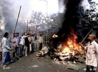 The riots began after a train fire killed 60 Hindu pilgrims
