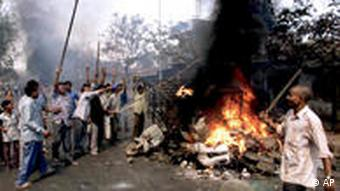 Hindu mobs attacked Muslims across Gujarat, burning homes and businesses in riots after the Godhra incident