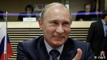Russia's Prime Minister Vladimir Putin gestures as he attends a meeting with the European Commission