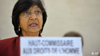 U.N. High Commissioner for Human Rights, South African Navanethem Pillay, delivers her statement during the Human Rights Council Special Session on the situation of the human rights situation in Libya at the European headquarters of the United Nations in Geneva, Switzerland, Friday, Feb. 25, 2011. Sign reads in French : UN High Commissioner for Human Rights. (AP Photo/Keystone/Martial Trezzini)