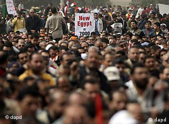 Egyptian protesters attend Friday prayers in Tahrir Square,