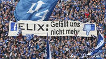 Schalke fans hold a sign of disapproval for Magath