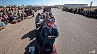 People waiting to cross the border between Libya and Tunisia