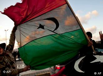 A man walks through roadblocks in Tripoli