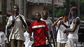 people walking through street in Abidjan