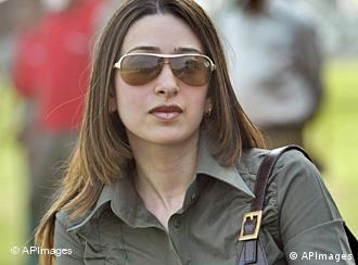 **FILE** Bollywood actress Karisma Kapoor looks on during a polo match in New Delhi, India, in this Sunday, Oct. 23, 2005 file photo. Kapoor is ready to return to acting after the birth of her daughter, she said in an interview published Sunday March 5, 2006. (AP Photo/Rajesh Kumar Singh, File)