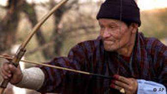 In the villages, people use traditional bows made from bamboo