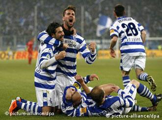 Duisburg players celebrate their second goal