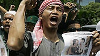 Indonesian Muslims of Islam Defenders Front (FPI) shout slogans during a protest against Q! Film Festival in Jakarta