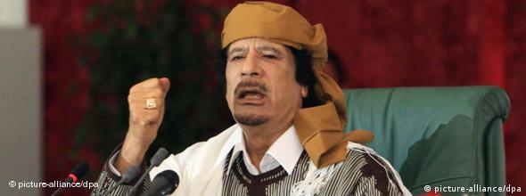 Libyan leader Moammar Gadhafi gestures during a speech