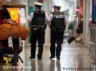 Two armed police officers patrolling Frankfurt airport