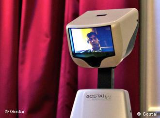 A robot with a human videoconferencing on the monitor that is its head