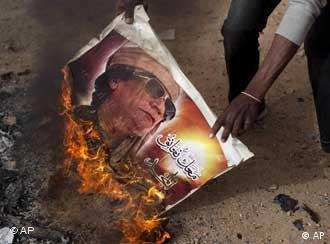 A picture of Moammar Gadhafi is burned in Benghazi, March 2 , 2011