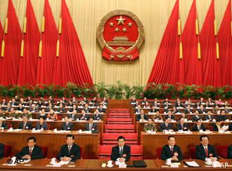 Top Chinese leaders, from left, Luo Gan, Wu Guanzheng, CPPCC Chairman Jia Qinglin, President Hu Jintao, Premier Wen Jiabao, Vice President Zeng Qinghong, and Li Changchun attend the Fourth Session of the Tenth National People's Congress (NPC) held at the Great Hall of the People in Beijing March 5, 2006. (AP Photo/Xinhua/Ma Zhancheng)