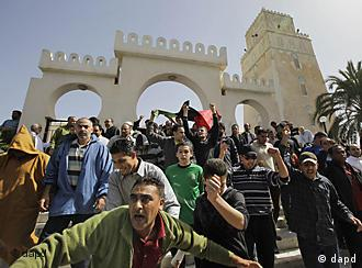 Anti-Gadhafi protesters leave the Muradagha mosque to resume their protests