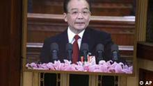 Chinese Premier Wen Jiabao, seen on a display, delivers the government report at the opening session of the annual National People's Congress at the Great Hall of the People in Beijing, China, Saturday, March 5, 2011. In a speech Saturday that is China's equivalent to a state-of-the-nation address, Premier Wen said there would be more assistance to working class and rural Chinese who have not benefited from the country's rapid growth. (Foto:Ng Han Guan/AP/dapd)