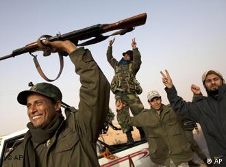 Libyan rebels who are part of the forces against Libyan leader Moammar Gadhafi celebrate their victory in fighting against troops loyal to Gadhafi, in the oil town of Ras Lanuf, eastern Libya, Saturday, March 5, 2011