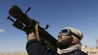 An Libyan rebel with an anti-aircraft gun