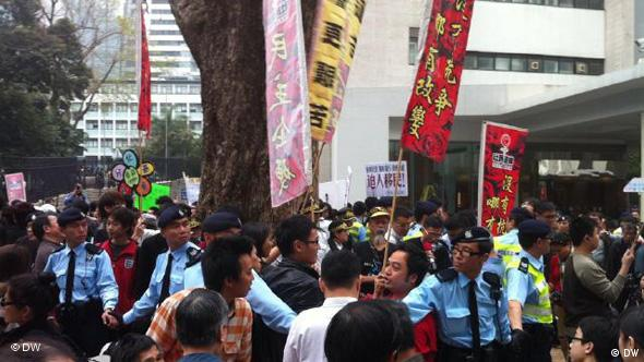 Despite massive security dozens dared come out to protest across China at the weekend