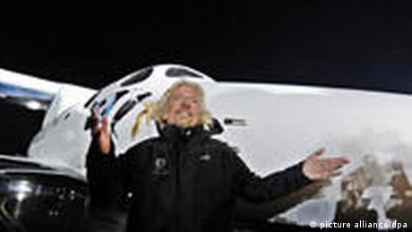 Virgin Group's Richard Branson stands in front of SpaceShipTwo during the rocket plane's worldwide debut.