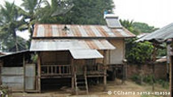 A hut in rural China with a solar panel on the roof