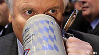 Horst Seehofer, drinking from a big, Bavarian beer mug