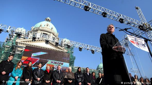 epa02565229 Serbia's opposition Progressive Party leader Tomislav Nikolic (front R) speaks during a major anti-government rally in Belgrade, Serbia, on 05 February 2011. Tens of thousands of Serbian opposition supporters gathered in Belgrade on Saturday to protest economic hardship, corruption and demand early elections from President Boris Tadic. The opposition bloc led by the nationalist Serbian Progressive Party (SNS) threatened to launch continuous protests if Tadic ignores the call for the polls. The opposition demands the resignation of the government, quicker European integration and early elections, claiming the government is corrupt and inefficient. EPA/SRDJAN SUKI