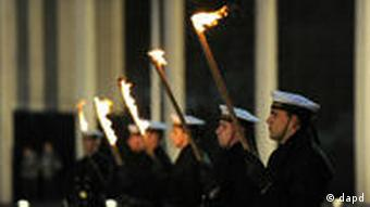 soldiers holding flaming torches