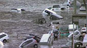 Vehicles washed away by tsunami in coastal area in eastern Japan