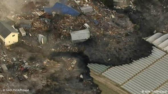 Houses are washed away by tsunami in Sendai, Miyagi Prefecture eastern Japan